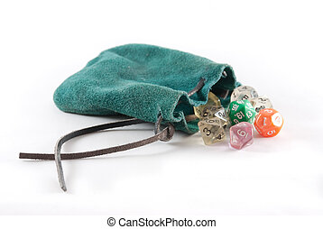 Green leather pouch with many sided dice falling out on...