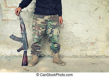 old submachine gun kalashnikov AK-47 - man hold old...