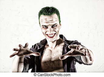 guy with crazy joker face, green hair and idiotic smike....