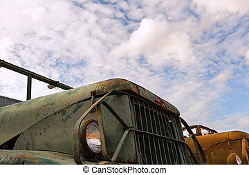 antique military truck grunge with rust, parking on the...