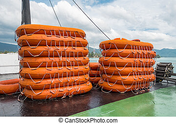 life buoy stack on ship or boat for security and safety concept background