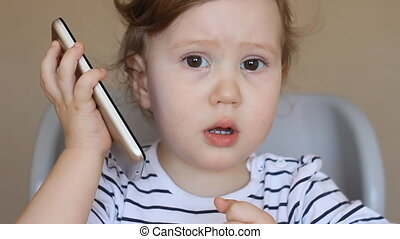The child speaks by phone