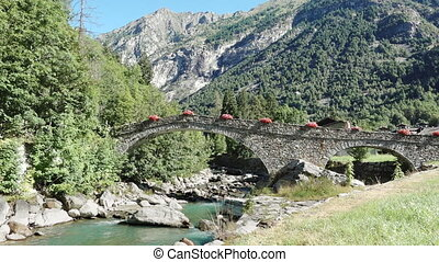 Ancient medieval stone arch bridge mountain river travel...