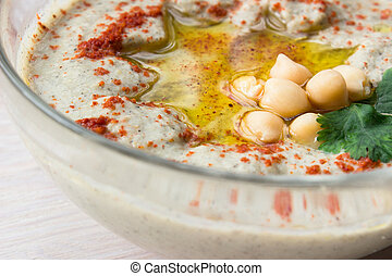 closeup of A bowl of creamy hummus with olive oil. - closeup...