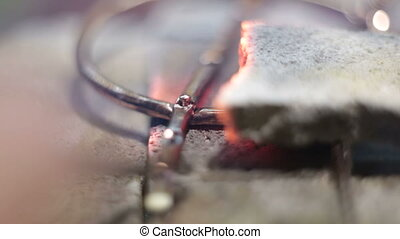 Compound thin products at high temperature on the hot stones of fire.