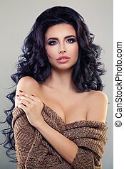 Sexy Brunette Woman with Curly Hair and Perfect Makeup. Fashion Model, Permed Hairstyle and Make up