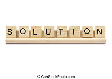 Word ''solution'' on scrabble wooden letters on a rack,...