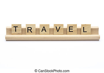 Word ''travel'' on scrabble wooden letters on a rack,...