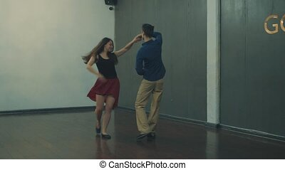 A couple dancing in the hall, 4K
