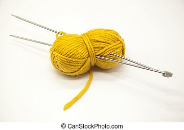 Yellow ball of yarn for knitting with spokes on a white background.