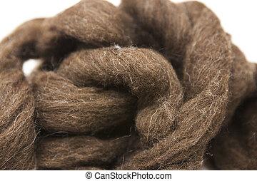 Brownpiece of Australian sheep wool Merino breed close-up on...