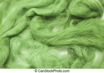Olive green piece of Australian sheep wool Merino breed...