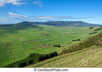 Farm fields in the Terceira island valley in Azores - Top...