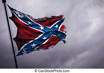 closeup of ripped tear grunge old waving confederate flag of...
