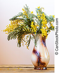 Still life with yellow spring flowers. Acacia dealbata known...