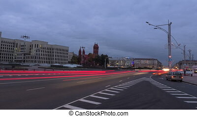 From day to night city traffic. Zoom out, time-lapse shot