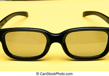 Glasses with black frame on yellow background