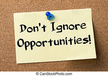 Don't Ignore Opportunities! - adhesive label pinned on...