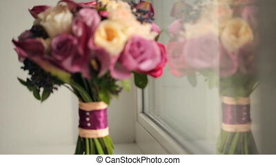 flower arrangement wedding bouquet standing on window sill...