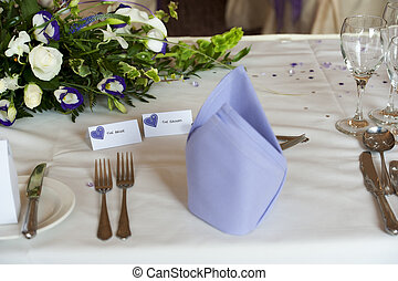 table setting at wedding breakfast with bride and groom tags