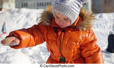child playing in the Playground in the winter