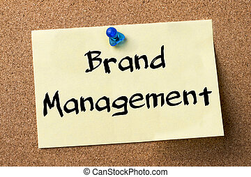 Brand Management - adhesive label pinned on bulletin board -...