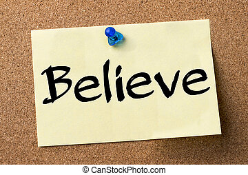 Believe - adhesive label pinned on bulletin board -...
