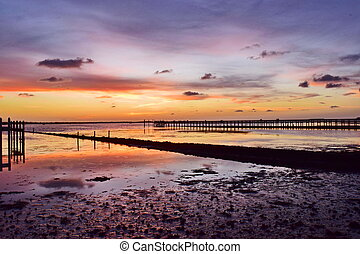 Low Tide Sunset Gulf Coast Florida - Colorful sunset over...