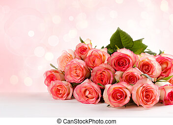 Bouquet of pink roses over pink background,selective focus