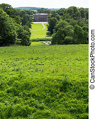 Green Rolling Hills and Manor House at Donneraille Park in Cork Ireland