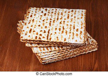 matzo on a wooden table - matzo flatbread for Jewish high...