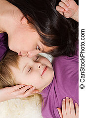Mother kissing daughter - Mother kissing sleeping daughter...