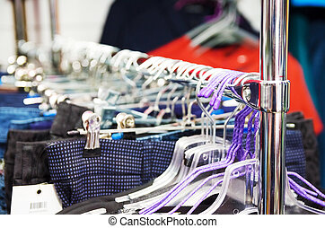 Countertop-hanger in the clothing and textile store, women's jeans clothes