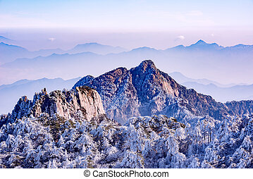 Winter sunrise landscape in Huangshan National park. Park...