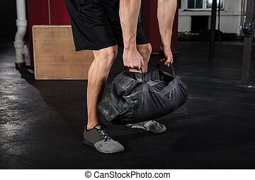 Man Working With Fitness Bag - Close-up Of A Young Athlete...