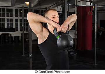 Man Exercising With Kettle Bell - Portrait Of An Athlete Man...
