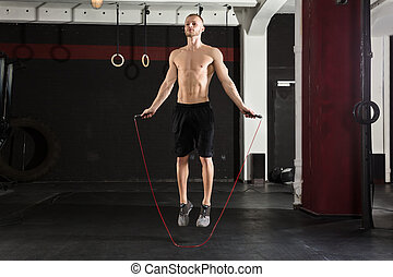 Man With Jumping Rope In The Gym