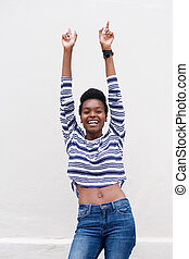 cheerful young black woman pointing fingers up