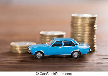 Car Model In Front Of Stacked Coin