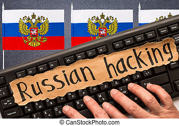 Russian hacking, inscription on torn paper sheet. Russia...