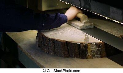 Carpenter sanding log slice with band grinder - Joinery...