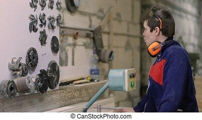 Carpenter installing circular saw blade on machine - Skilled...