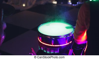 the game on the glowing drums