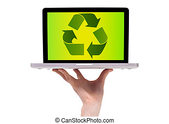 a male hand holding a laptop with recycle icon