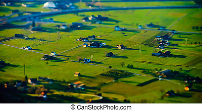 Miniature tilt-shift aerial view of the village in Alps,...