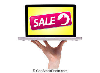 a male hand holding a laptop with sale sign