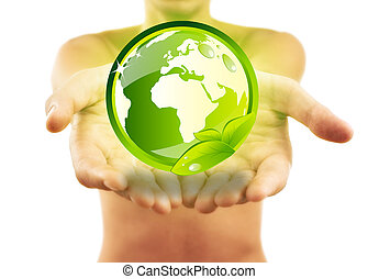 Hands holding earth with green leafs isolated on white