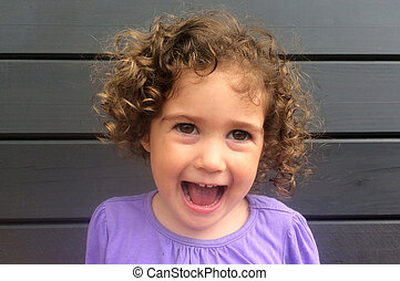 Happy and laughing curly child girl - Curly child (girl age...