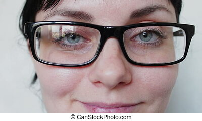 Close-up shot of woman eyes in glasses - beautiful girl with...