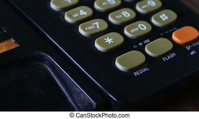 Old black telephone with the buttons